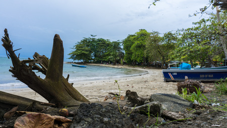 Costa Rica Small Boat On The Coast Of Puerto Viejo With Wood At The Beach Imagens