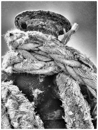 bollard: Bollard with ship ropes.