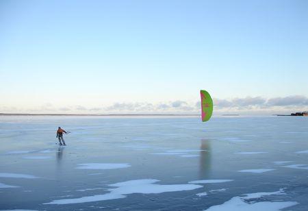 Snow kiting on a frozen lake Stock Photo