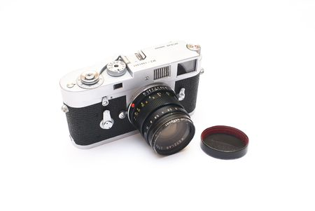 Old vintage rangefinder photo camera isolated over white background Stock Photo - 4244689