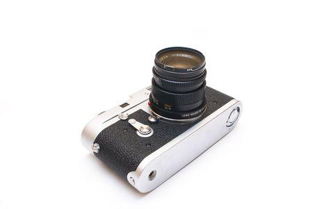 Old vintage rangefinder photo camera isolated over white background Stock Photo - 4244687