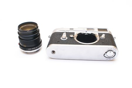 Old vintage rangefinder photo camera isolated over white background Stock Photo - 4244688