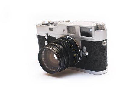 Old vintage rangefinder photo camera isolated over white background photo