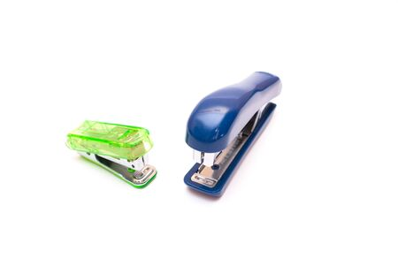 stapling: Staplers green blue isolated on white
