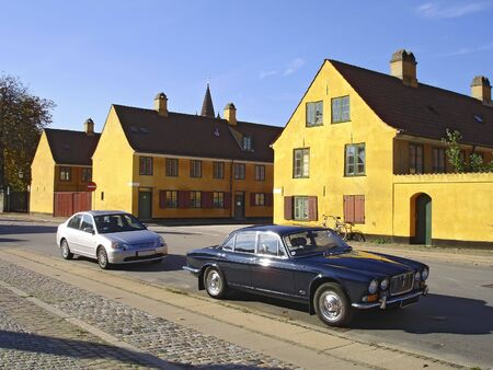 Old yellow houses (more than 300 years old) in the center of Copenhagen, the capital of Denmard.  Stock Photo