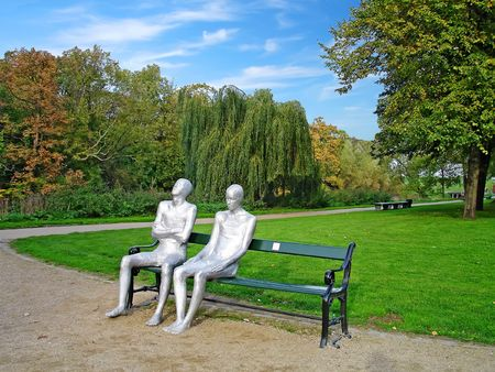 A couple sitting on a bench - monument by icelandic sculpturer in the centre of Copenhagen, Denmark                                Stock Photo