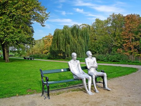A pair sitting on a bench - monument by icelandic sculpturer in the centre of Copenhagen, Denmark