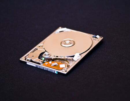 Hard disk drive isolated on black background photo