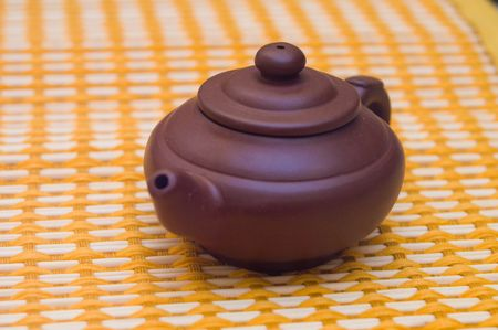 Small brown teapot on a table-cloth