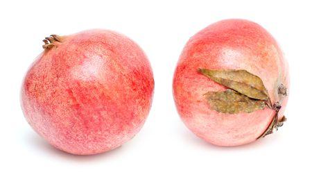 Ripe pomegranate seeds isolated on white photo