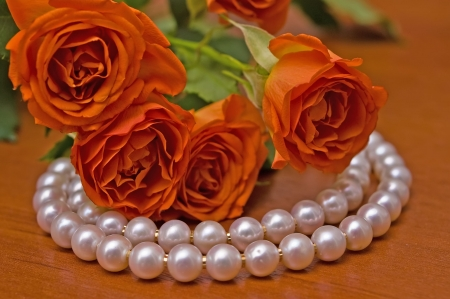 Elegant pearl neclace and beautiful roses Stock Photo
