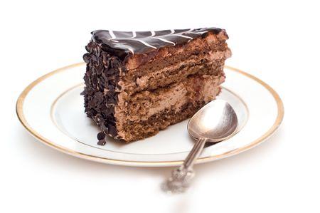 porcion de torta: Sabroso pastel de chocolate en un plato  Foto de archivo