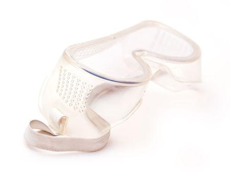 elementos de protección personal: Goggles de seguridad sobre fondo blanco  Foto de archivo
