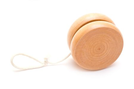 tied down: Wooden yo-yo toy isolated on white