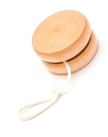 play yoyo: Wooden yo-yo toy isolated on white