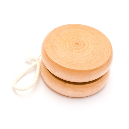 Wooden yo-yo toy isolated on white photo