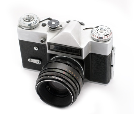 Vintage SLR photo camera isolated on white background Stock Photo - 8409650