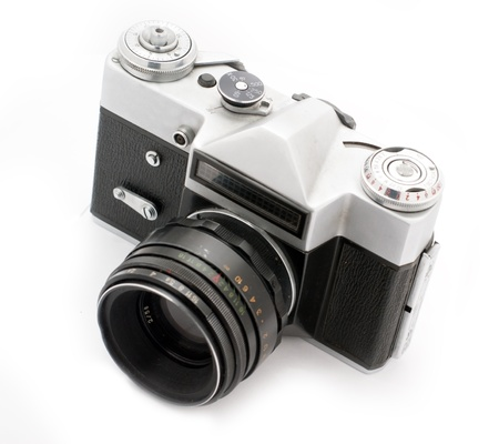 Vintage SLR photo camera isolated on white background Stock Photo - 8409646