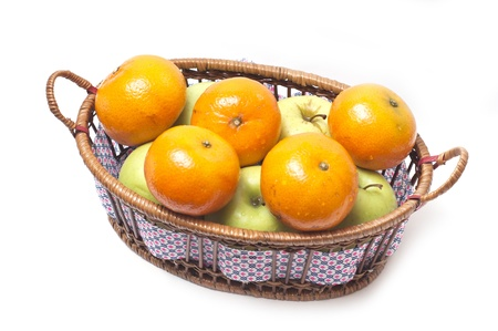 Tangerines and apples in a basket isolated on white background Stock Photo - 8410304