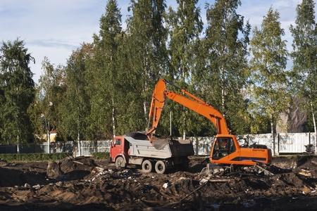 Excavator loading dump-truck photo