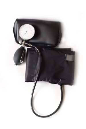 Blood pressure sphygmomanometer isolated on white photo