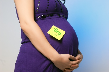 Beautiful pregnant woman belly - Girl sign