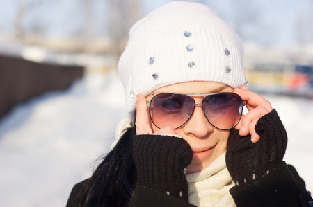 Winter Girl in a sunglasses Stock Photo