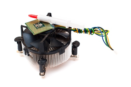 Old microprocessor and fan over white