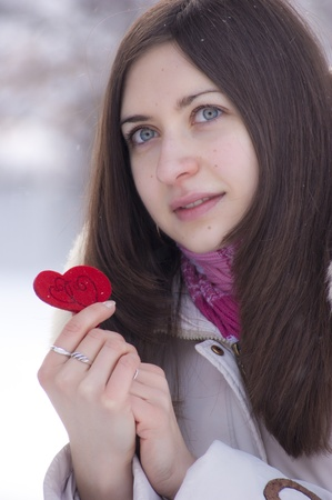 Teen girl heart in his hands Stock Photo