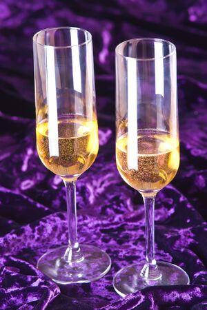 velure: Two wineglasses with champagne on velvet