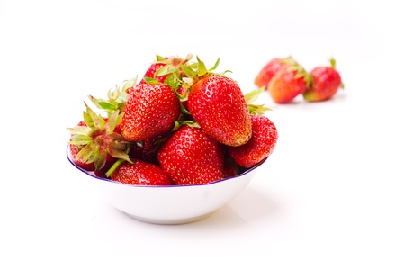 The fresh cut strawberries on white Stock Photo