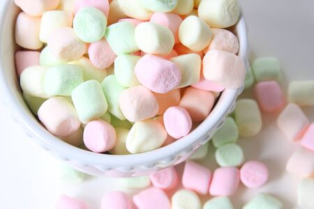 soft colors: White bowl of pastel colored marshmallows