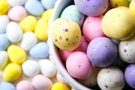 Pastel Easter candy, filled with chocolate, close-up in white bowl