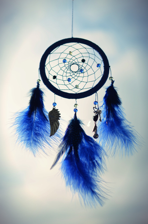 dreamcatcher: blue dreamcatcher hanging on a sky background Stock Photo