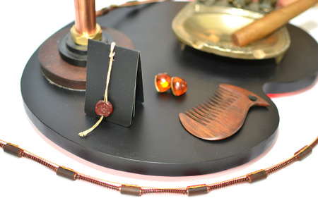 Ashtray with cigar, printing of wax and amber earrings photo