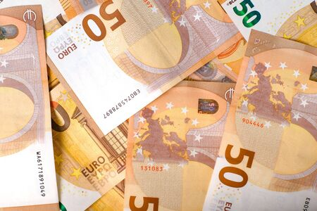 50 Euro banknotes in pattern, full frame . Euro banknote as part of the economic and trading system. Close-up