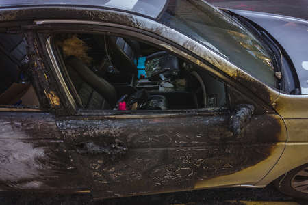 Burnt car from the side on a street in Lower East Side, Manhattan Stock Photo