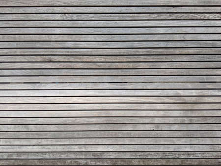 Close-up of old wood texture of pallets background. Horizontal lines of wooden boards