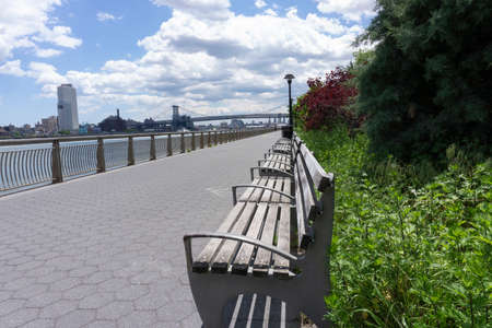 An empty promenade along East River in lower Manhattan