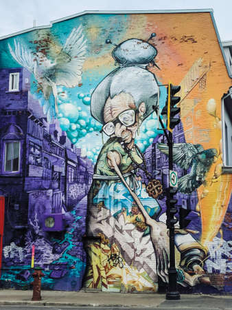 Mural on one of the wall building in Montreal, Canada. Artistic expression as a street art.