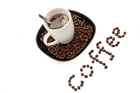 caffiene: coffee beans and cup of coffee on the plate