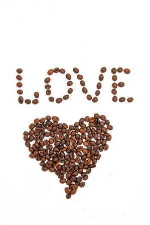 caf: Coffee beans shaped like heart Stock Photo