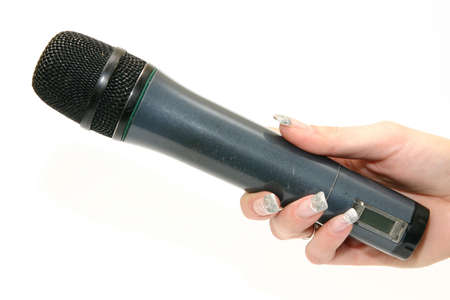 womans hand holding black microphone isolated on white photo