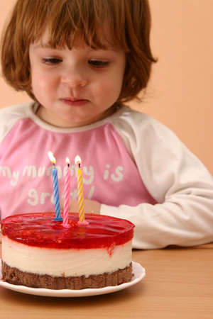 little girl and her birthday cake with candles Stock Photo - 783412