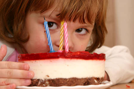 morsel: little girl taking a mouthful of her birthday cake