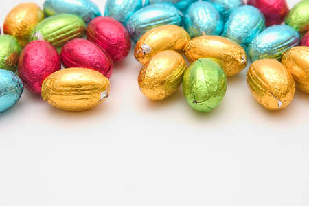Colorful Easter eggs chocolates with copy space on the bottom