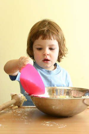 homemade cookies: little girl preparing homemade cookies Stock Photo