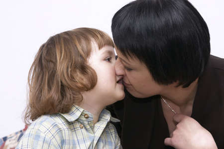 little cute girl kissing her aunt isolated on white Stock Photo - 870276