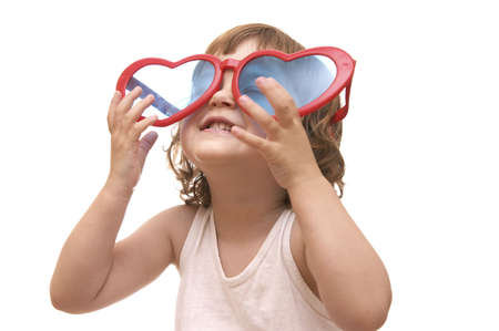 little girl, wearing funny, heart shaped, sunglasses, isolated on white Stock Photo - 956450