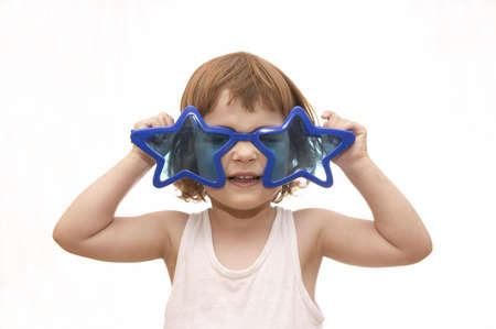 little girl, wearing funny, star shaped, sunglasses, isolated on white Stock Photo - 956451